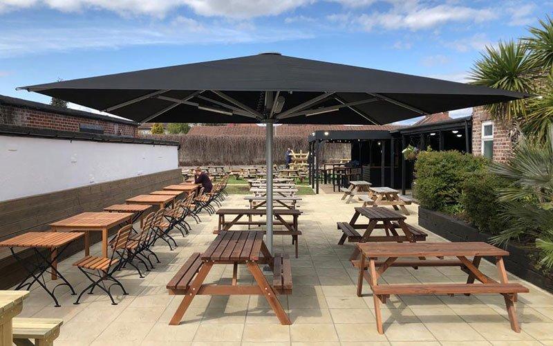 Huge Jumbrella part of the outdoor pub refurbishment at Brook House